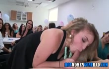 Party girls blowing at party